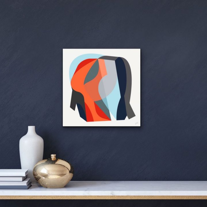 Red, blue and gray abstract artwork having on dark wall